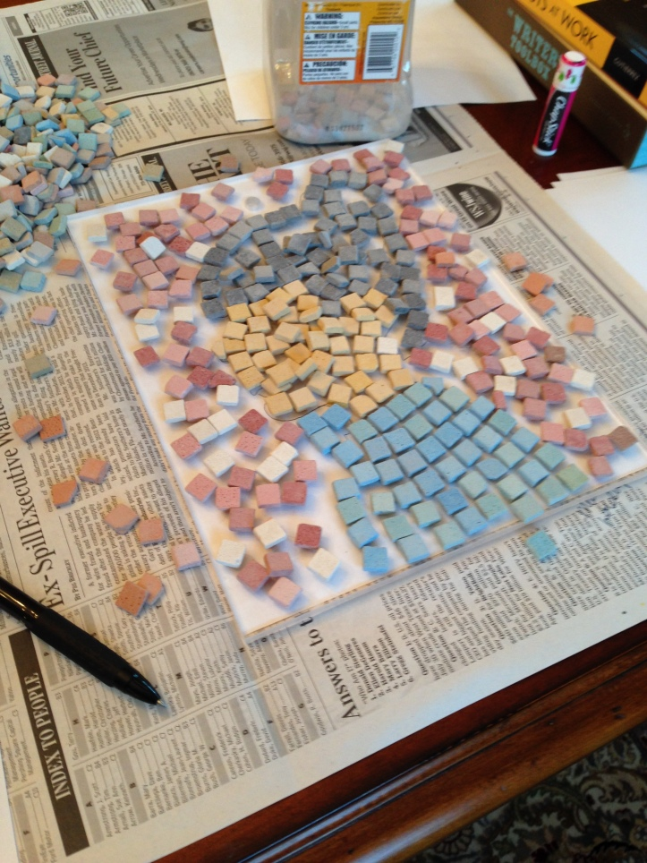Setting aside enough stones for each part of the mosaic.