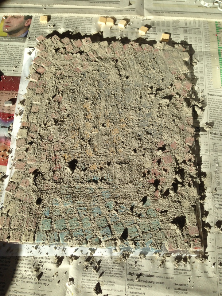 The mosaic covered in my too thick grout.
